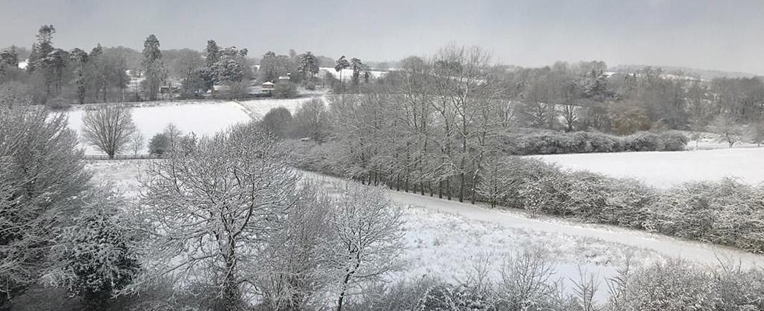 letterbox crop of coddenham snowy winter hills and dark sky